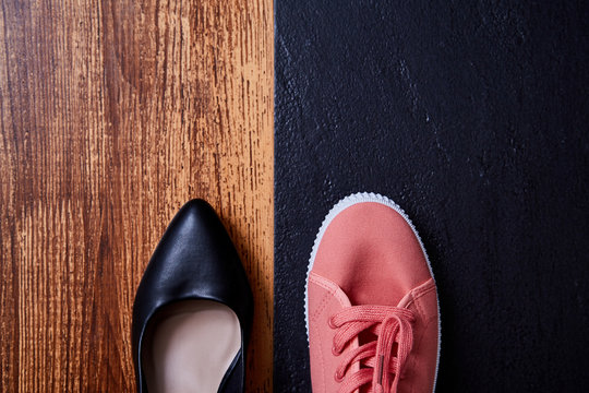 Work life balance choice concept: colored sneakers or sports shoes and strict office shoes