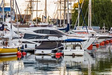 Yachts and sailboats in marina dock port