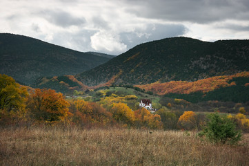 Small village in valley at autumnal day