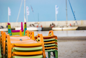 Colorfoul deckchairs with sand and beach