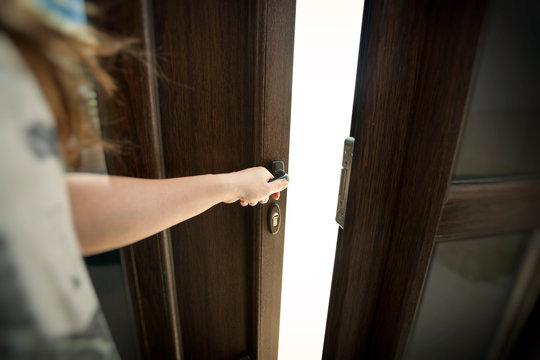 The woman's hand opens the new plastic door