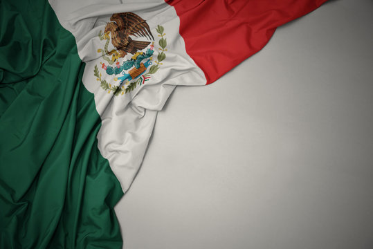 waving national flag of mexico on a gray background.