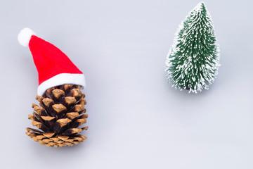 Pine crone with Santa hats and tree