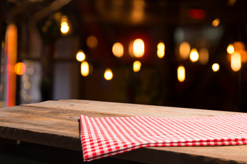 Wall Mural - Table background with napkin and blurred bar background space