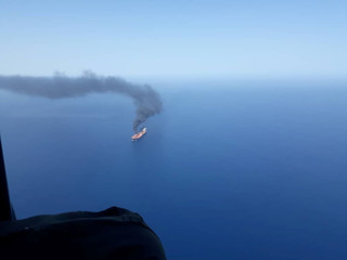An oil tanker is seen after it was attacked in the Gulf of Oman