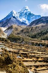 Scenic valley and Ama Dablam peak on the trek between Tengboche and Dingboche, Nepal.