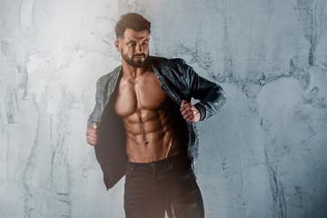 Muscular Men in Jeans Wearing Jacket But Exposing his Muscular Torso