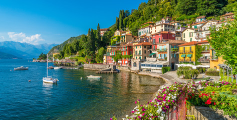 Beautiful Varenna waterfront on a sunny summer afternoon, Lake Como, Lombardy, Italy.