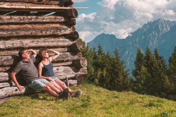 Young couple enjoying view in the Austrian Alps Wall mural