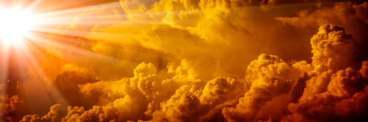 Bright Sunlight Shining Through Orange Clouds