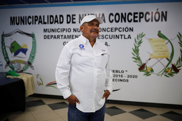 Otoniel Lima, mayor of La Nueva Concepcion, poses for a photo after an interview with Reuters at the municipality of La Nueva Concepcion