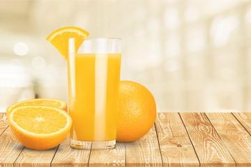 Obraz Orange juice and slices of orange on background - fototapety do salonu