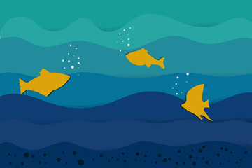 paper cut yellow fish on blue waves