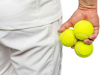 A man holds tennis balls in his hands. Back view. Close-up. Isolated on a white background.