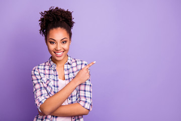 Portrait of her she nice charming cute attractive lovely cheerful wavy-haired girl in checked shirt showing aside ad advert product copy space isolated over violet purple pastel background Wall mural