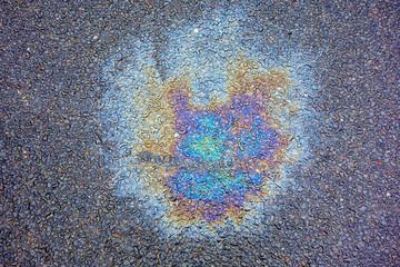 Oil Petrol Pollution Leak Rainbow Stain on Pavement