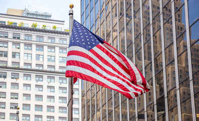 Wall Mural - American flag in Manhattan New York downtown