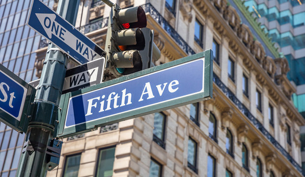5th ave, Manhattan New York downtown. Blue color street signs,