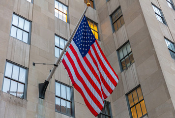 Fototapete - American flag in Manhattan New York downtown