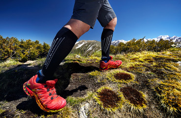 Legs of runner in mountains
