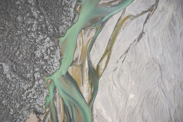 Landmannalaugar National Park - Iceland. Rainbow Mountains. Aerial view of amazing glacier river patterns. Top view. Picture made by drone from above.
