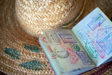 Passport and straw hat - concept tourism