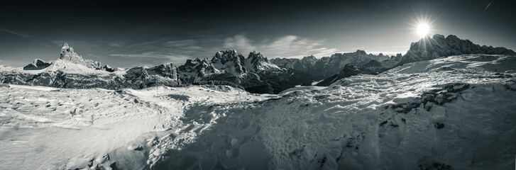 beautiful panoramic view on scenic landscape in tre cime di lavaredo dolomites mountain range in sunny snowy winter in black and white
