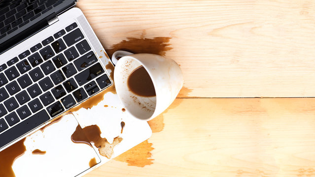 Coffee spilled into a computer notebook