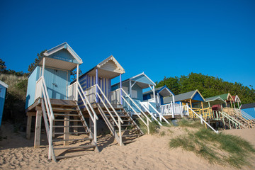 Fototapete - Medium Close up view of Beach Huts in Norfolk