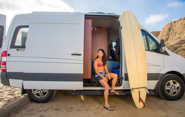 Female Surfer in camper