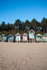 Fototapete - Portrait Format Beach Huts in Norfolk