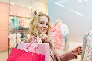 Young woman with bags while shopping
