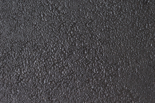 Wet asphalt background. Road dark grey  texture.