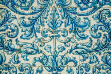 Blue floral pattern hand-painted on ceramic tiles at Caceres