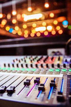 Sound recording studio mixer desk at a concert: professional music recording