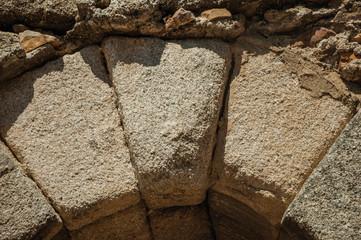 Keystone at the apex of a masonry arch at Merida