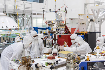 Handout photo of members of NASA's Mars 2020 project assembling the Mars 2020 rover in Pasadena