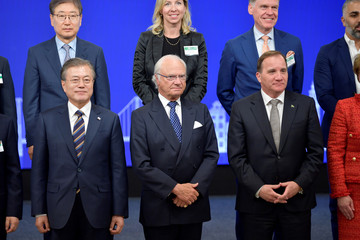 South Korea's President Moon Jae-in, Sweden's King Carl Gustaf and Sweden's Prime Minister Stefan Lofven pose for a family photo at the Sweden-Korea Business Summit in Stockholm