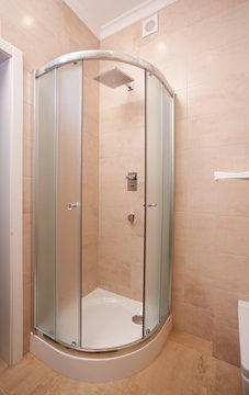 epmty minimalistic interior background, bathroom of modern apartment, shower cabin closeup in light colors