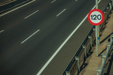 Empty highway with SPEED LIMIT signpost in Madrid