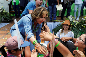 Sandra Torres, presidential candidate for the National Unity of Hope (UNE), greets supporters during her closing campaign rally in Villanueva