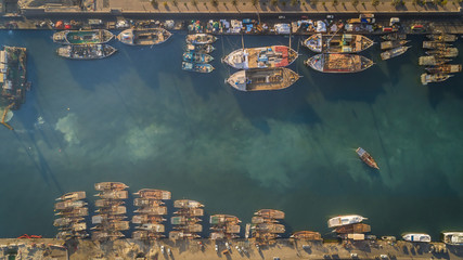 Aerial view of wooden boats moored in harbour near Flag Island, Dubai, UAE.
