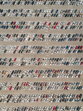 Aerial abstract view of cars parked outside Motiongate theme park, Dubai, UAE.