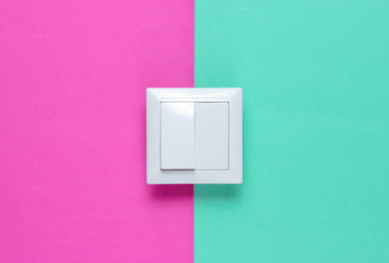 The switch on a colored paper background, minimalism