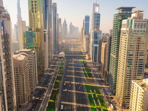 Aerial view of multi-lanes highway crossing the city, Dubai, U.A.E