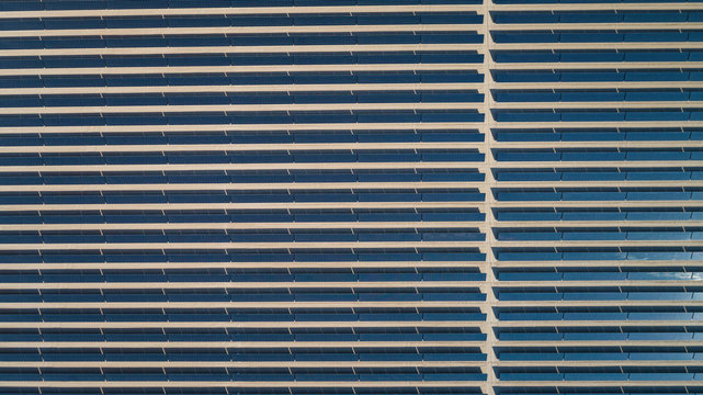 Abstract aerial view of a solar panel park in Saih Al Salam desert in Dubai, U.A.E.