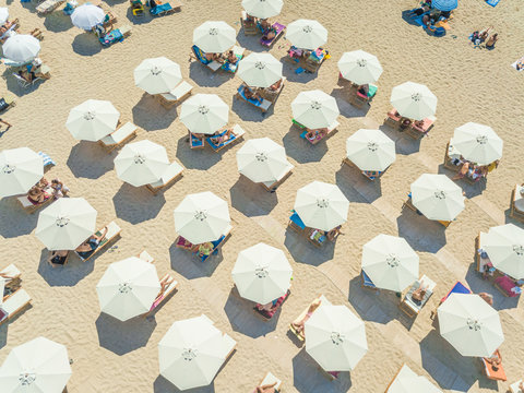 Aerial view of beach with white parasols on Achaia, Greece.
