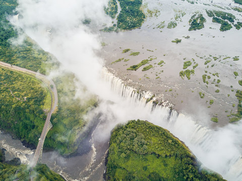 Aerial view of a bridge on Victoria falls on the Zambezi River at the border between Zambia and Zimbabwe.