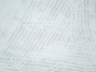 Abstract aerial view tracks in a snowy field in Estonia.