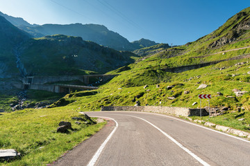 transfagarasan the most beautiful road in romania. amazing transportation scenery on summer morning. clear blue sky and some haze on the distant mountain tops